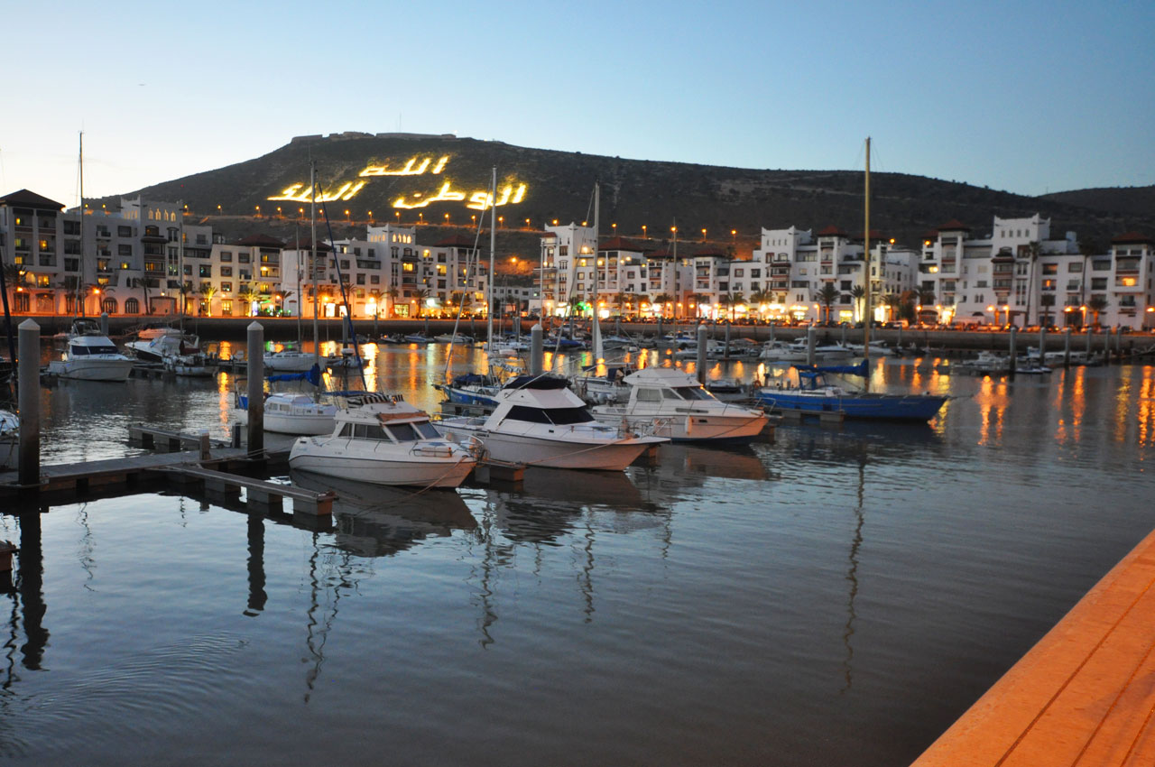 Agadir Marina, views of the illuminated mountain. The words read, 'God, King & Country'
