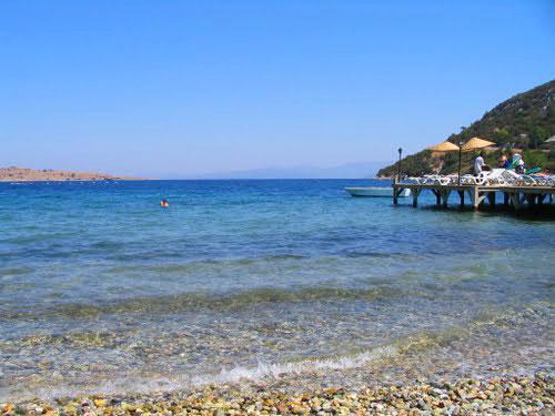 Golturkbuku, showing the vivid Aegean Sea and the pebbly beach