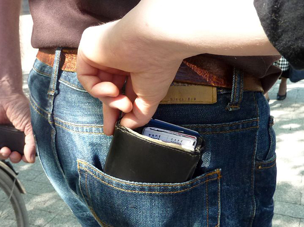 Pickpocket easily taking a wallet from the back pocket
