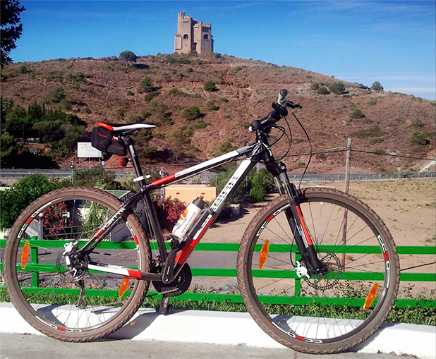 Mijas Wheels - a great way to see the sites and keep fit, pictured in the background is Torres de Fahala fortress. Image courtesy of Mijas Wheels