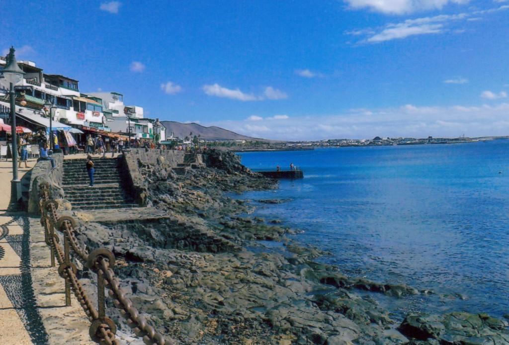 Playa Blanca promenade with restaurants, shops and bars overlooking the sea