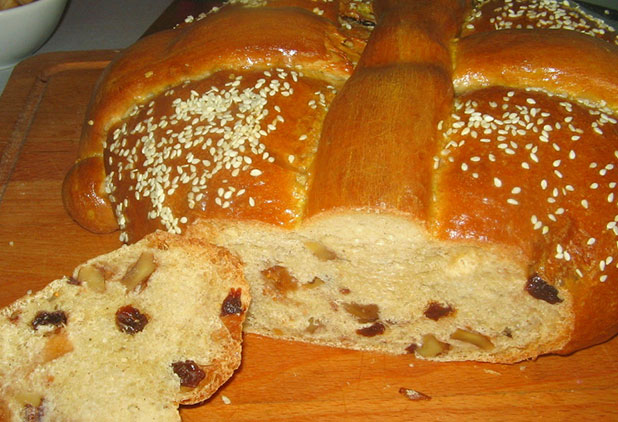 Christopsomo is a Greek festive bread made with orange, cloves, cinnamon and dried fruits
