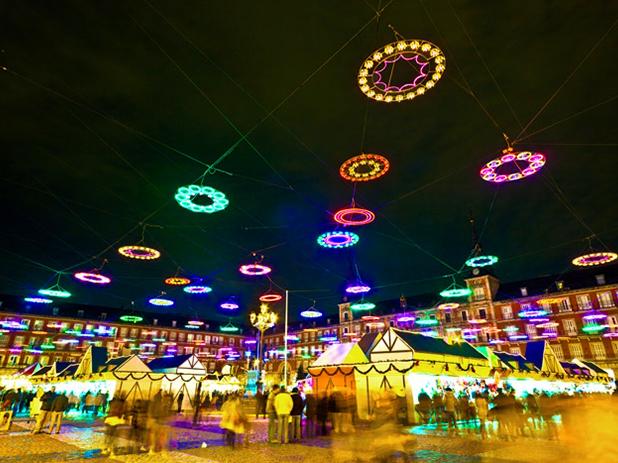 The beautifully illuminated central Plaza Mayor Christmas Market in Madrid
