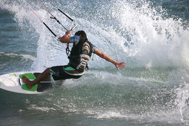 Kitesurfing in Estepona, a great all over workout for your core and upper body - photo courtesy of www.kitesurfestepona.com