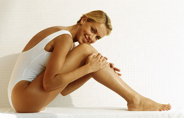 Smooth legs after waxing which lasts 2 to 8 weeks, perfect preparation for your holiday