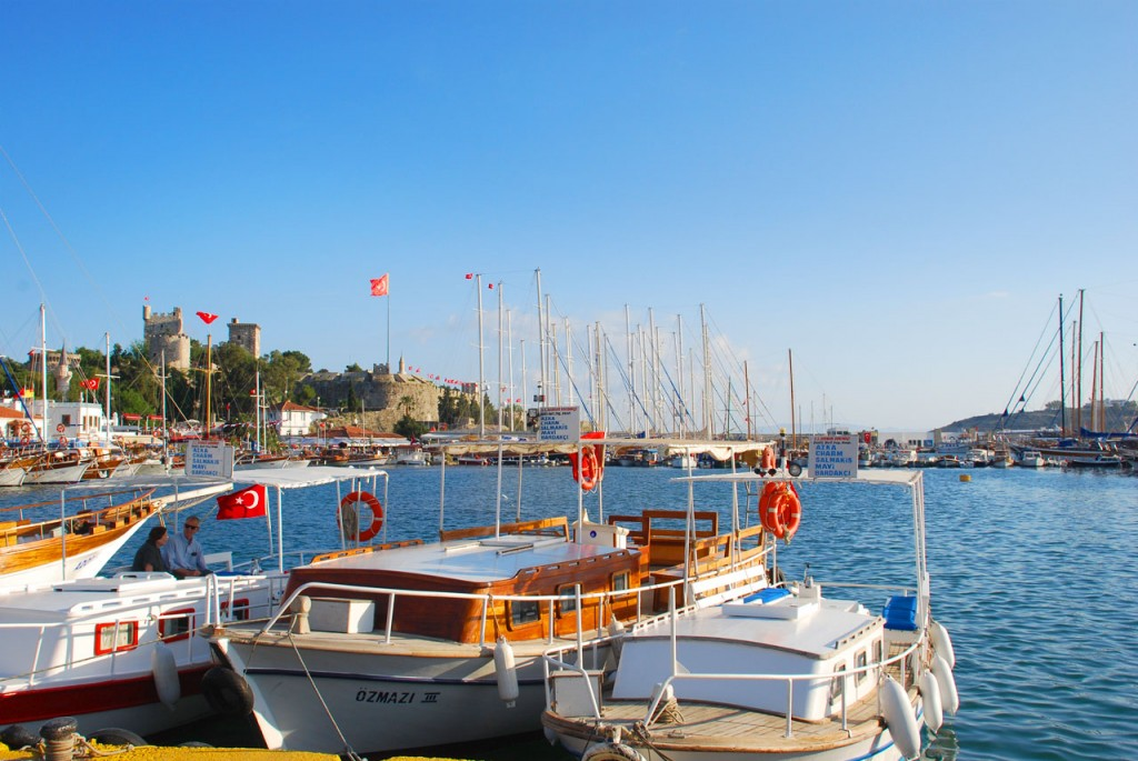 The historic Bodrum castle surrounded by many large yachts