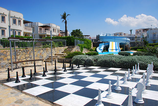 Giant chess with seating area and the waterslides can be seen further back