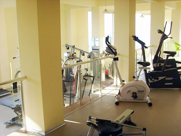 Upper level in the gym with rowers, bikes and cross trainers