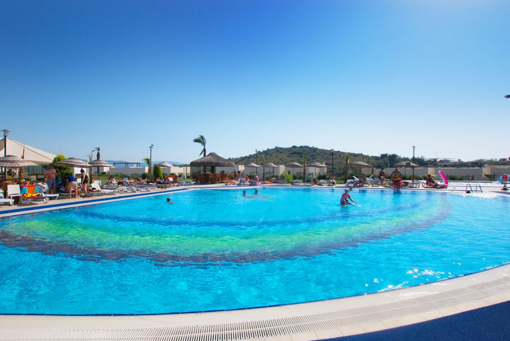 The main pool has plenty of space for sun loungers and parasols to relax near the poolside