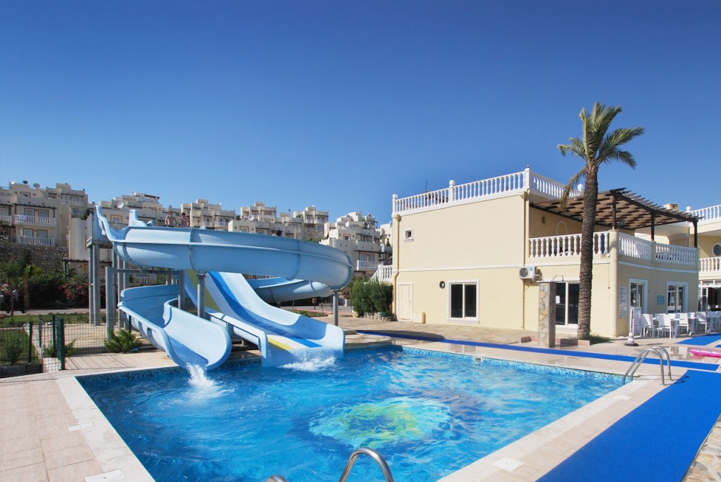 The two waterslides are sited to the side of the main communal pool