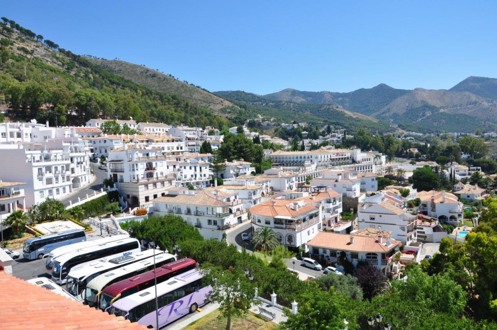 Mijas, showing the stunning mountain backdrop against the hillside and whitewashed houses