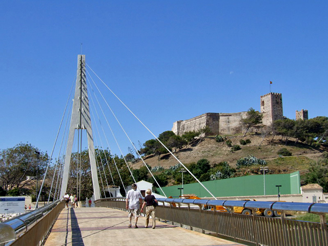 The attractive Castle bridge leading over the Fuengirola River, Sohail Castle can seen perched on the hillside