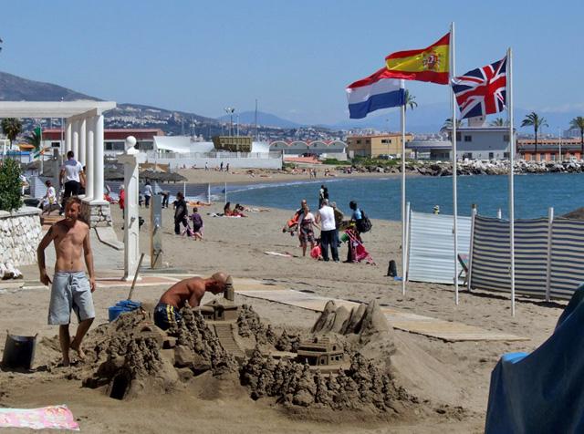 Sand sculptures in progress on Fuengirola beach, near the port