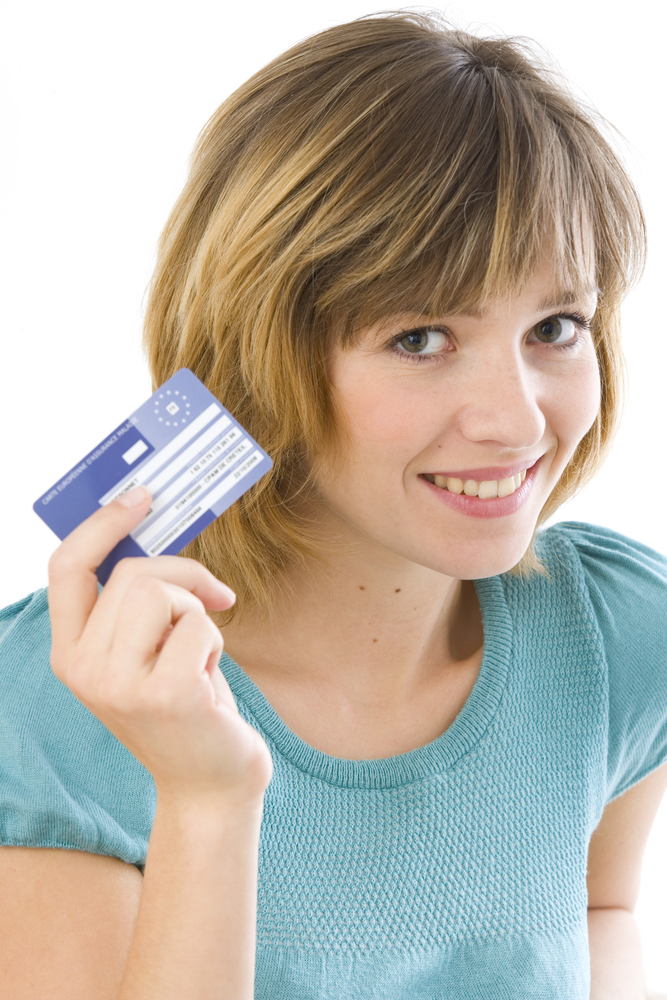 Woman holding a European Health Insurance Card