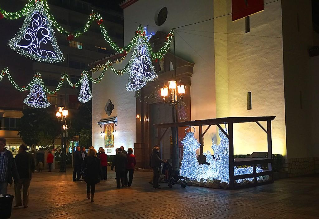 The Plaza de la Constitucion in Fuengirola, showing the illuminated lights and nativity scene