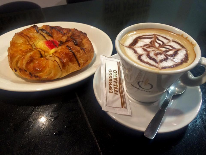 La Costa Café Bar in Los Boliches, shown is a traditional Spanish breakfast with pastry and Italian coffee