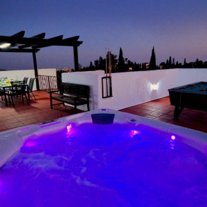 Villa SP001 showing the American style hot tub illuminated at night